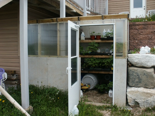greenhouse which is located off the southeast corner of our basement