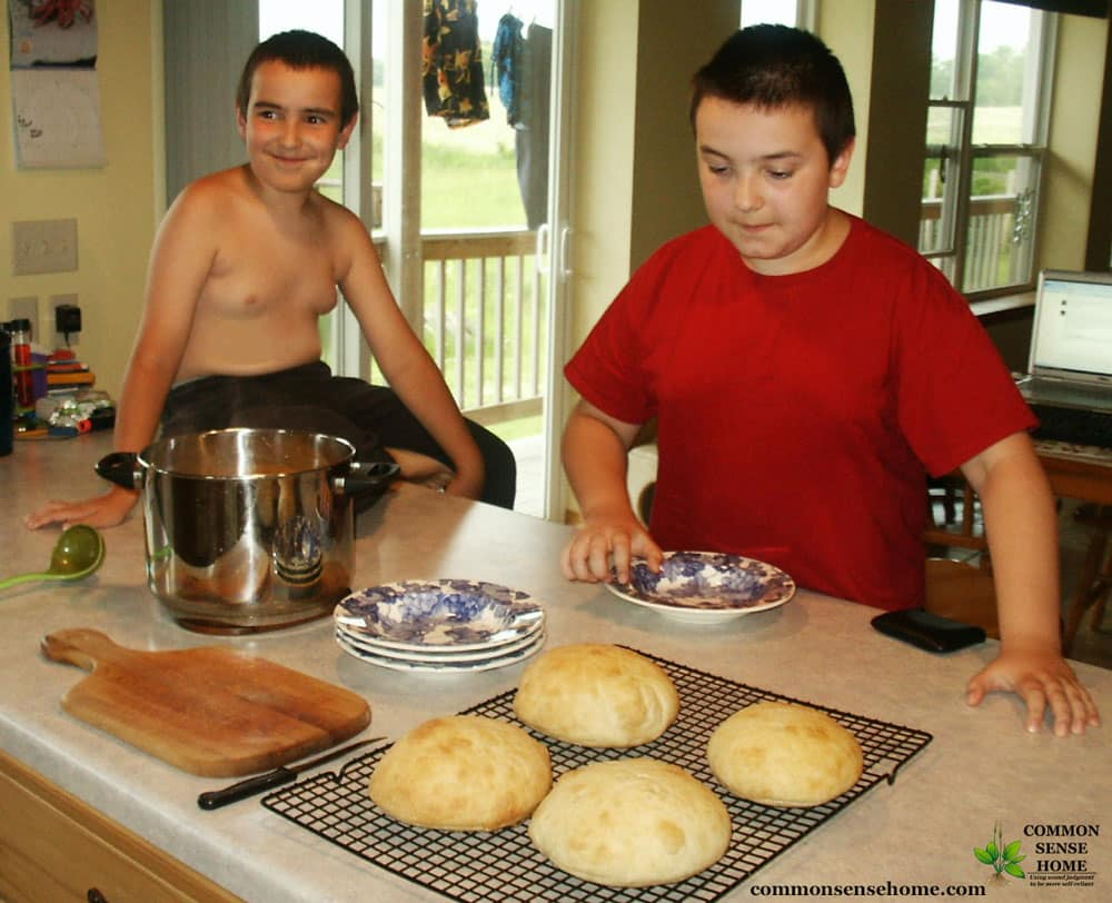 boys hungry for cheese soup in bread bowls