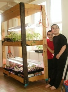 boys and plant stand
