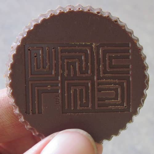 Unreal peanut butter cup back with Unreal logo
