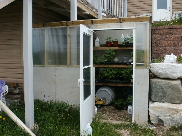 earth sheltered greenhouse attached to southeast corner of home