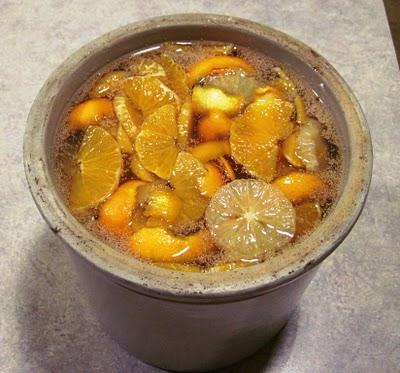 homemade dandelion wine ingredients in a crock