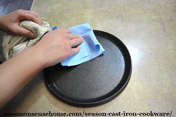 wiping off excess cast iron seasoning oil