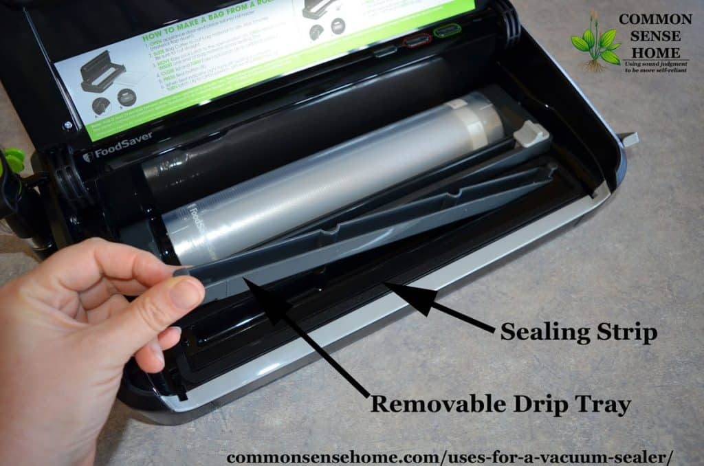 removable drip tray and sealing strip inside a FoodSaver vacuum sealer