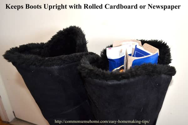 Boots kept upright with rolled cardboard