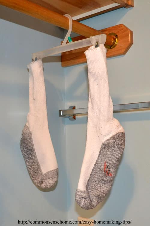 Socks drying on plastic hanger