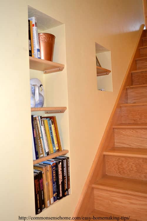 Shelves in wall alongside stairs