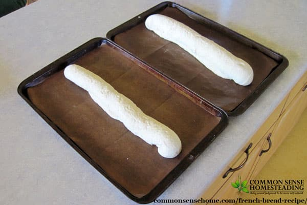 Easy homemade French bread on pans, getting ready to rise and bake.
