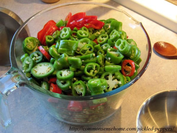 Pickled Peppers - Enjoy your hot peppers year round with this easy pickled pepper recipe for the water bath canner. Just 4 ingredients, use your favorite mix of hot peppers.