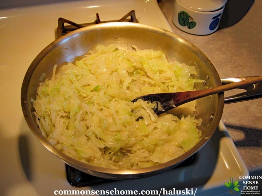 cabbage and onions in pan for haluski
