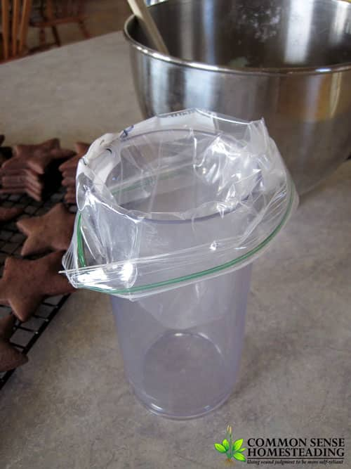 Placing the mint filling in a bag for icing the cookies