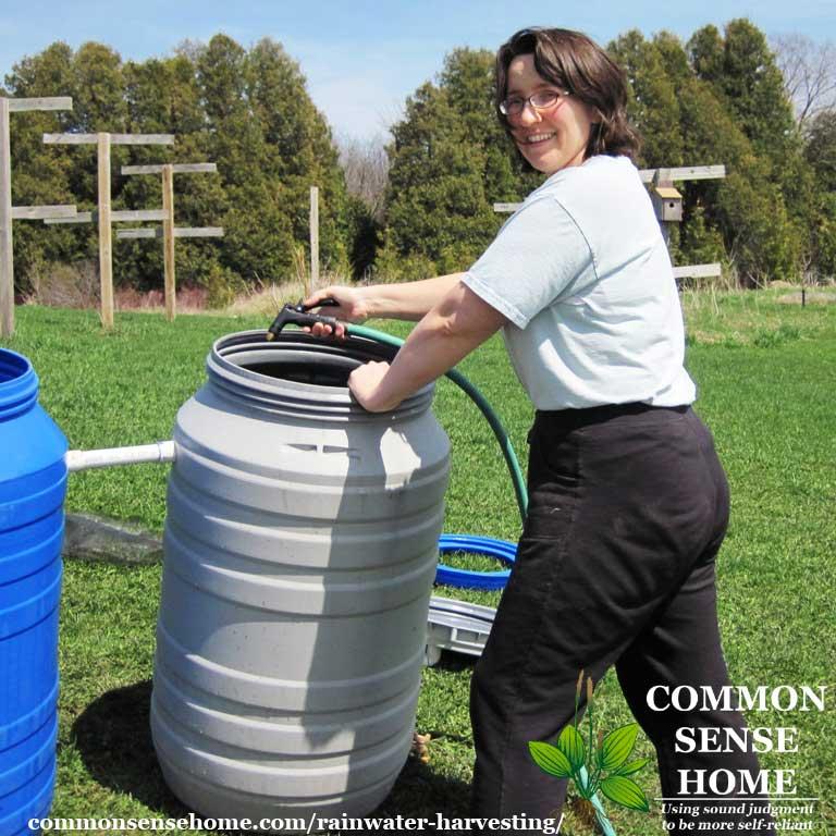 woman cleaning rain barrels