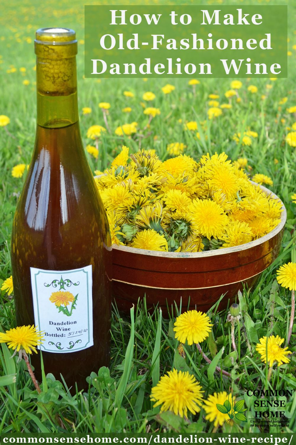 Bottle of homemade dandelion wine sitting next to a bowl of dandelion flowers