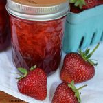 jar of strawberry jam and strawberries
