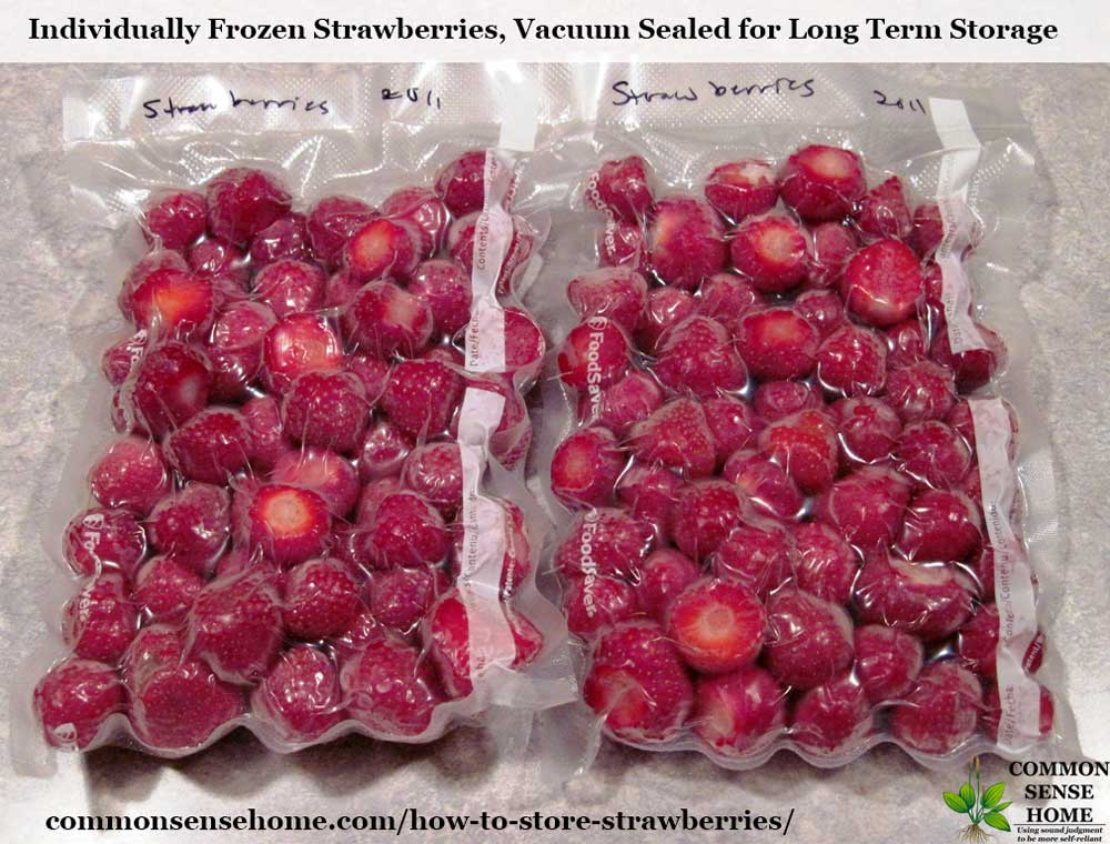 two packages of vacuum sealed frozen strawberries