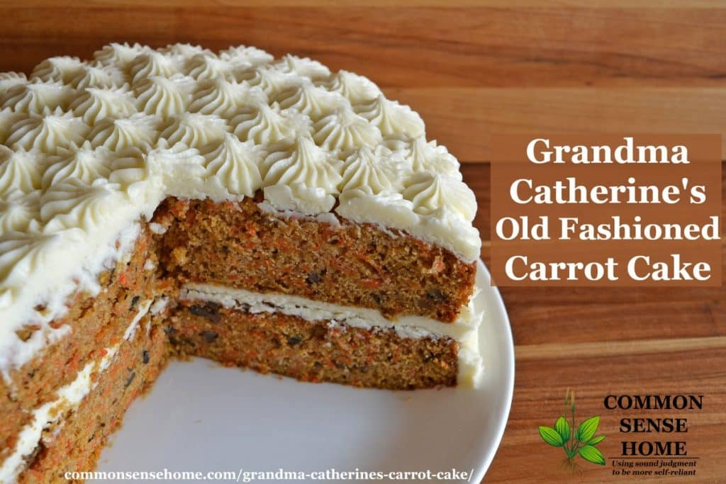 old fashioned carrot cake on white plate with wood background