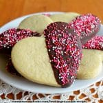 best sugar cookie cut into heart shape and dipped in chocolate with sprinkles