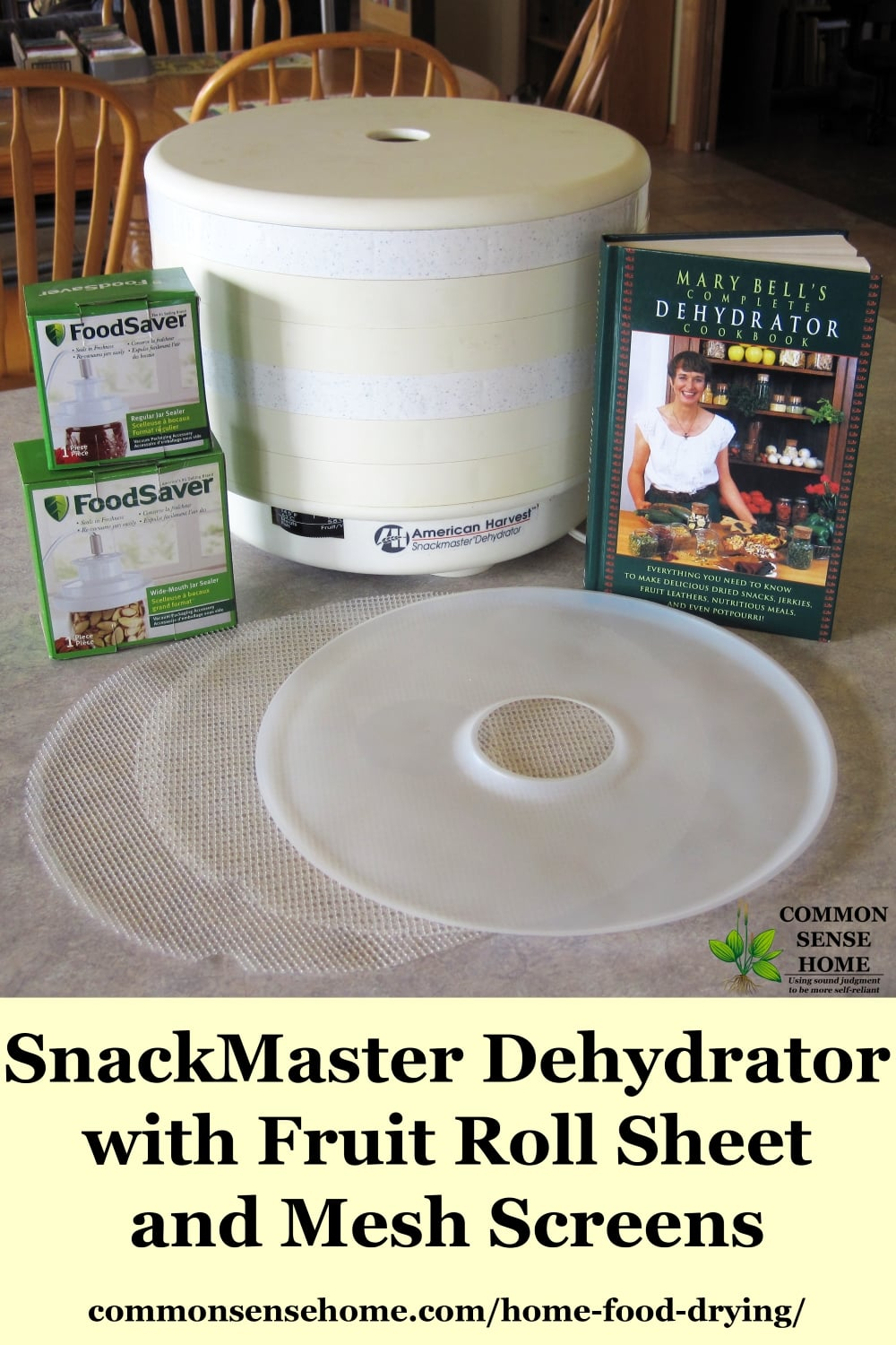 Snackmaster dehydrator on a table with accesories next to it