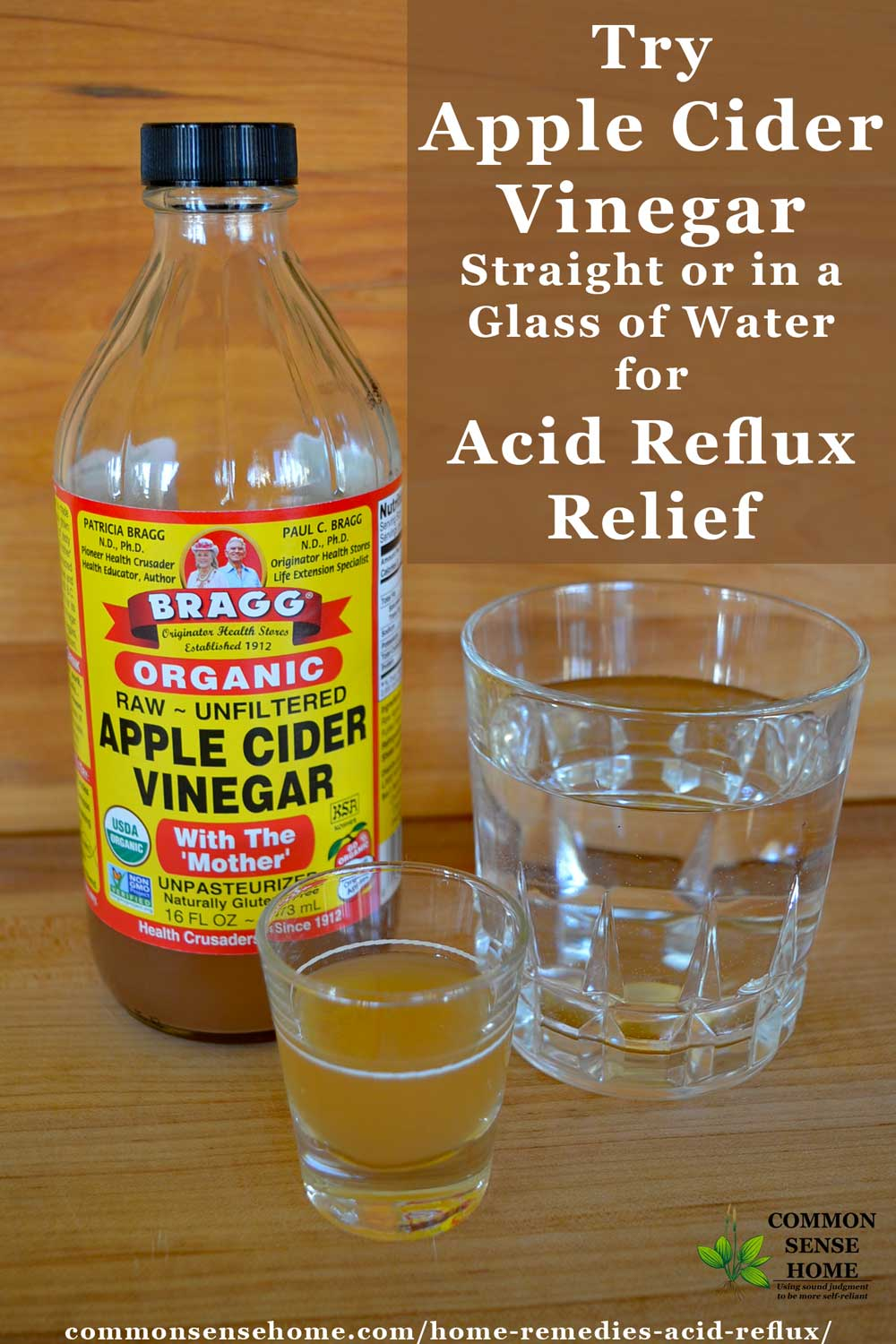 Apple cider vinegar shot glass alongside vinegar bottle and glass of water