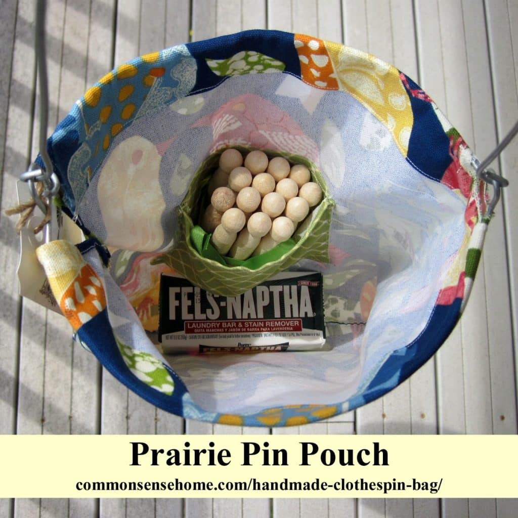 The Prairie Pin Pouch Handmade Clothespin Bag - top view, looking down into bag, with Fels-naptha soap and clothespins