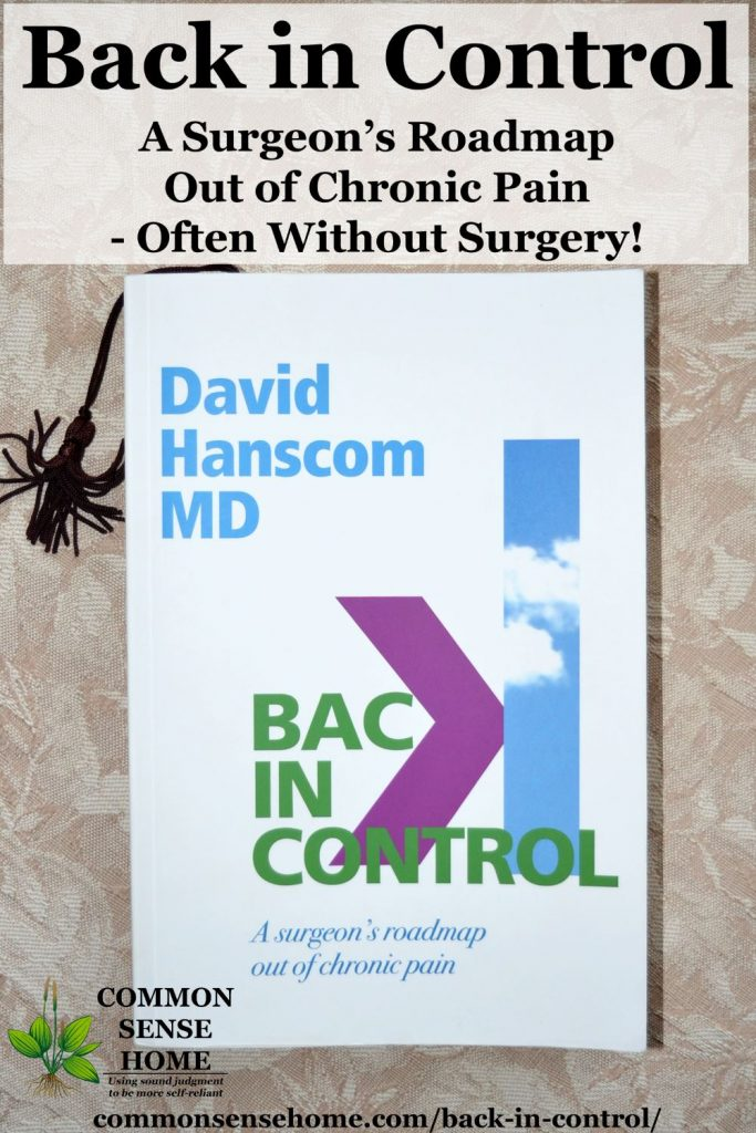 "A copy of the book ""Back in Control"" laying on a table"