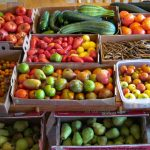 an assortment of fruits and vegetables ready for preserving