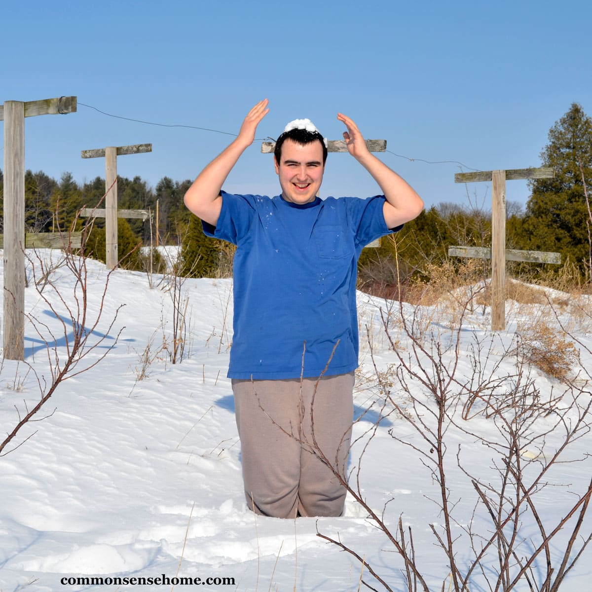 Young man in blue shirt cold training