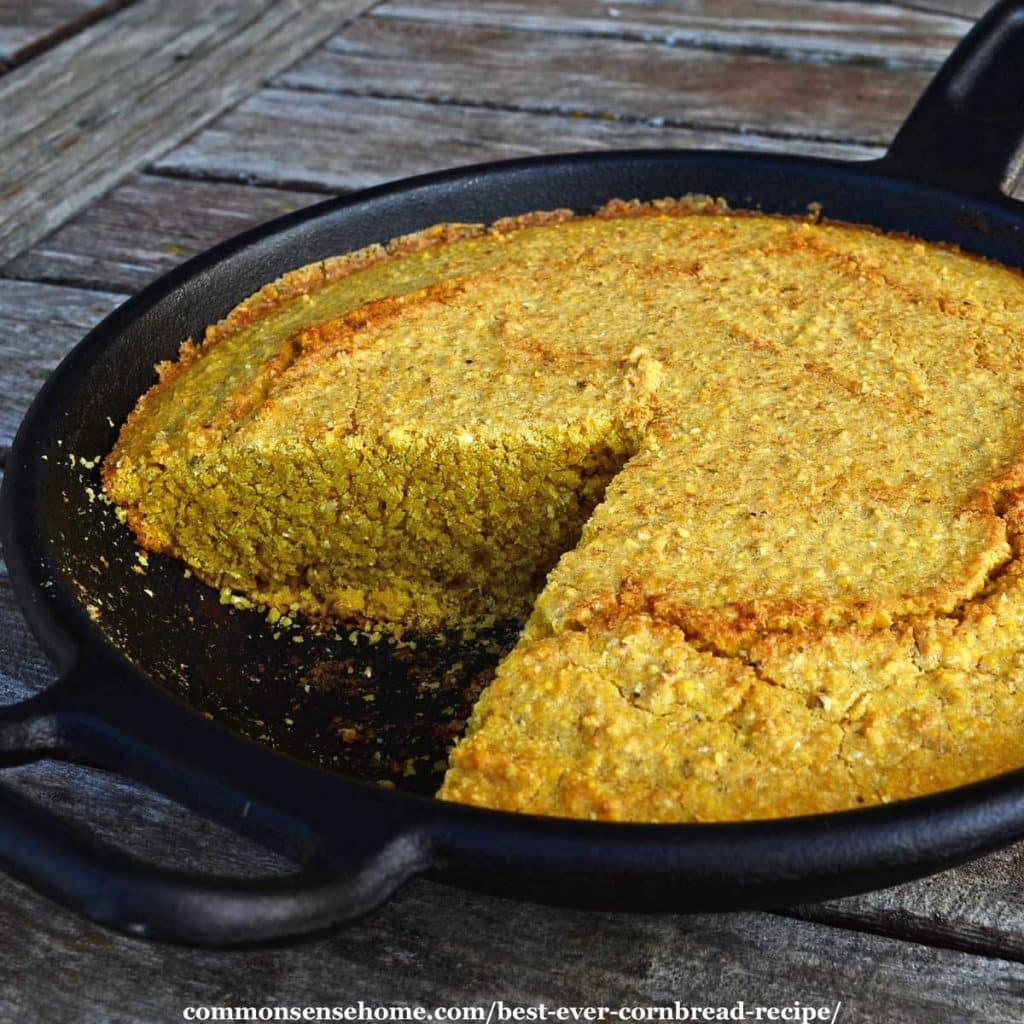 cornbread in cast iron skillet on wooden table