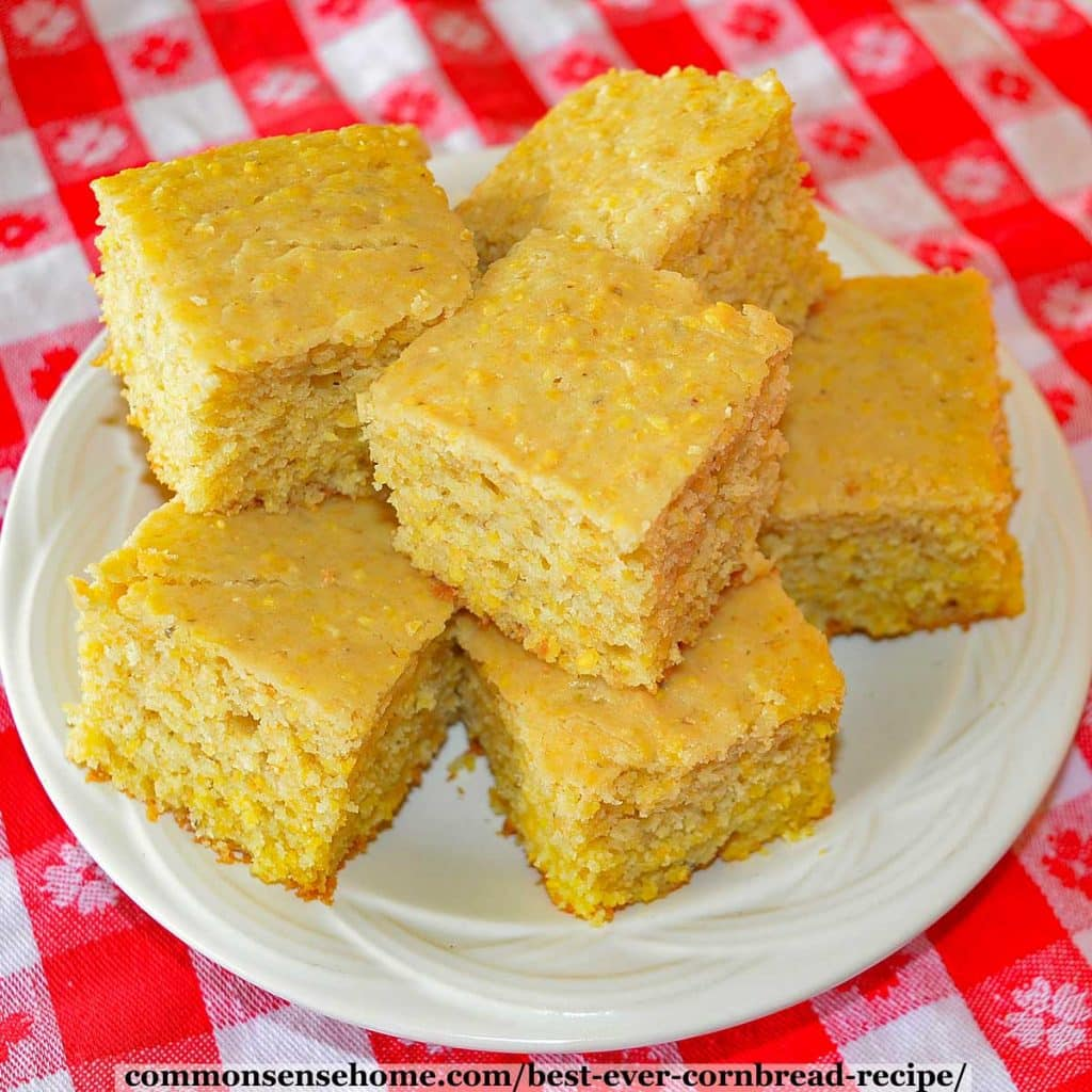 square slices of cornbread on white plate
