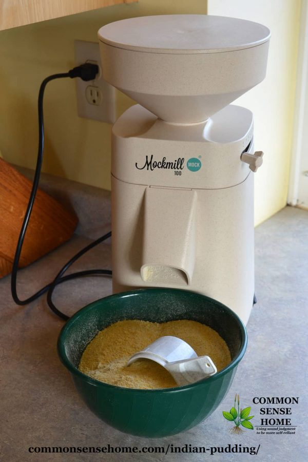 mockmill grain mill with bowl of fresh ground cornmeal