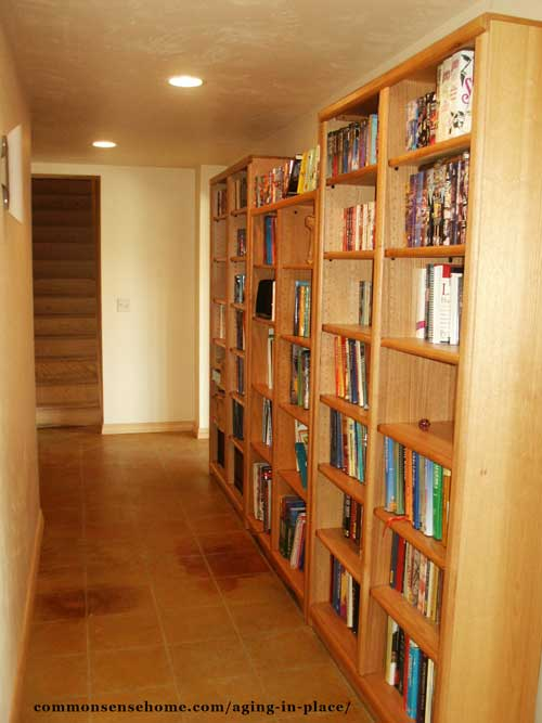 Bookshelves in the hallway allow for extra storage space.
