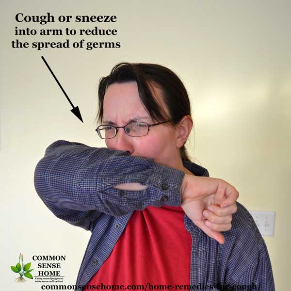 Demonstration of coughing into arm to reduce spread of germs