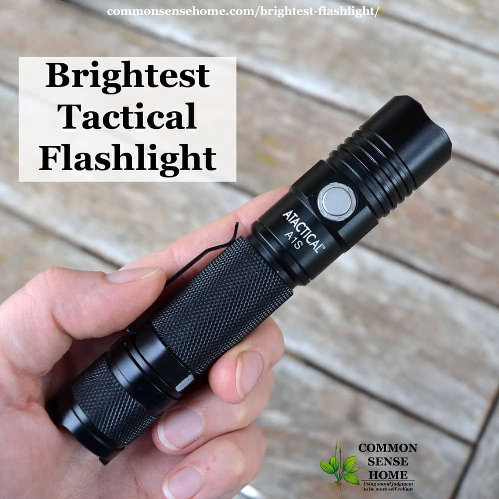 brightest tactical flashlight - black flashlight being held in hand