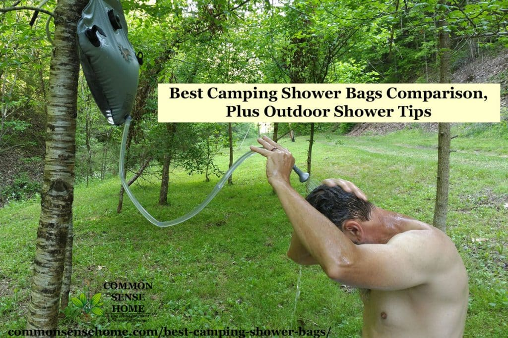 man washing hair with camping shower bag