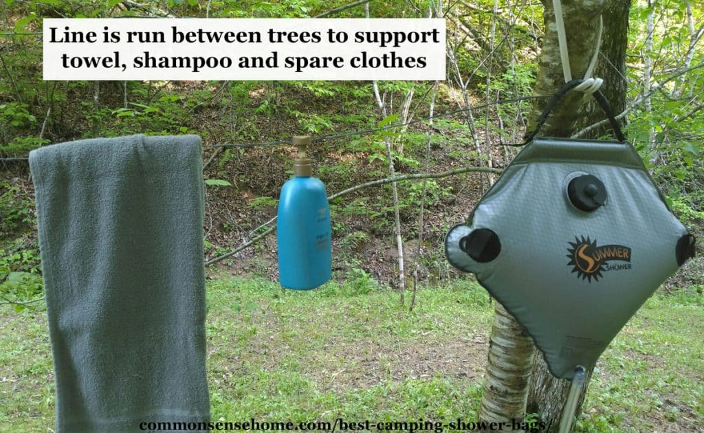 towel and shampoo on clothesline next to camping shower