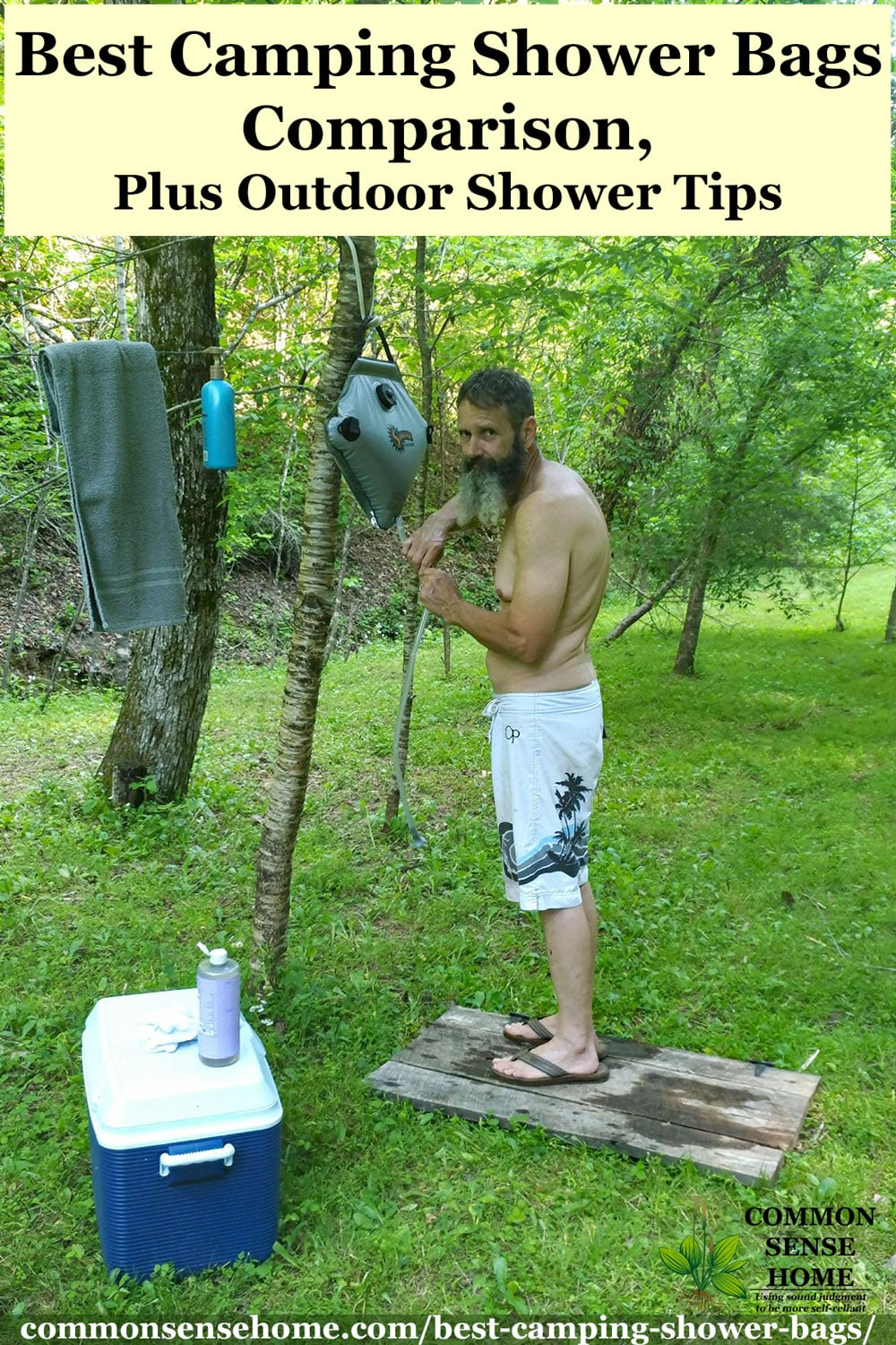 man preparing outdoor solar shower setup