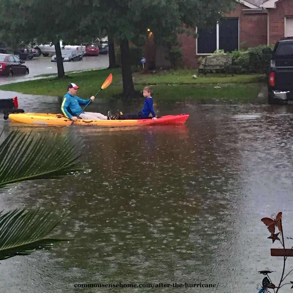 canoe in floodwaters after Hurricane Harvey