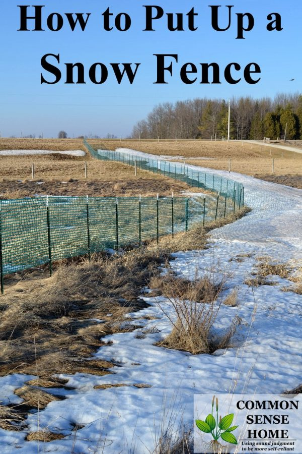 snow fence in field with snow drift
