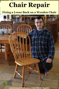 young man with wooden kitchen chair
