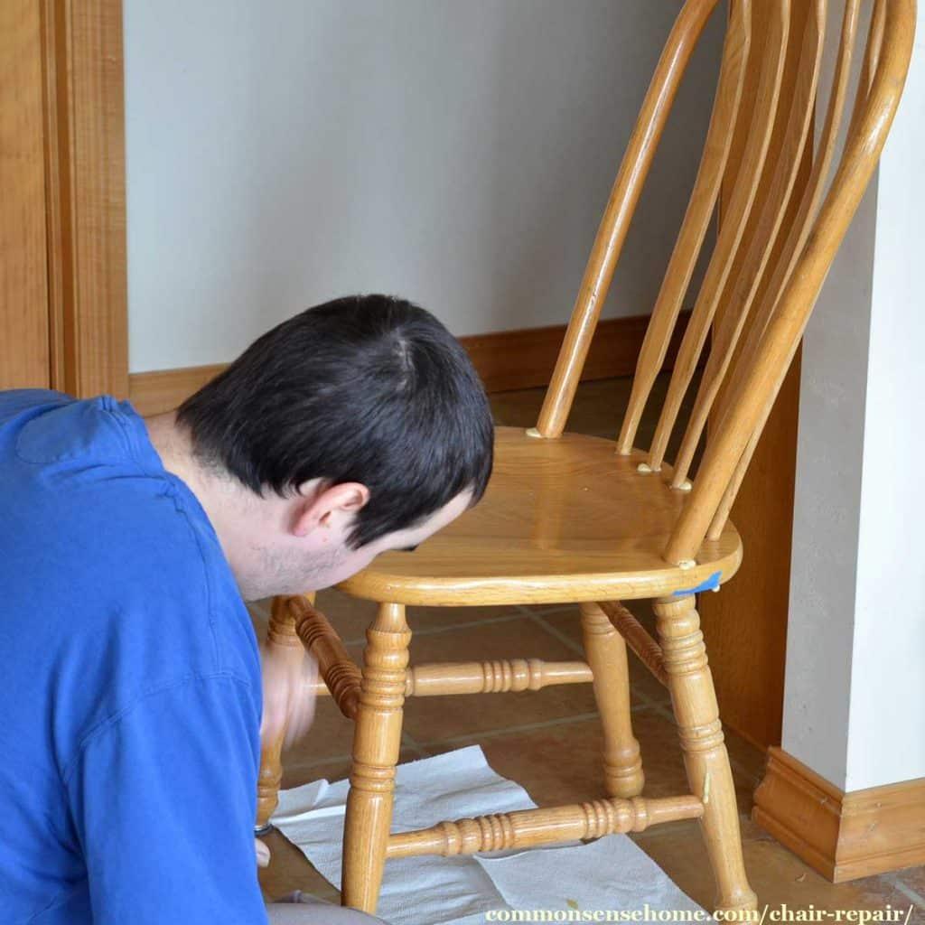 man repairing chair