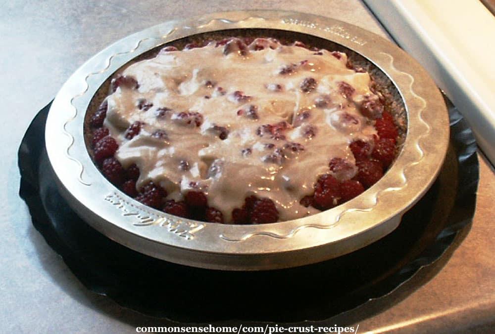 Raspberry pie with pie crust shield and drip catcher