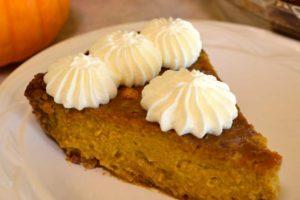 homemade pumpkin pie with whipped cream