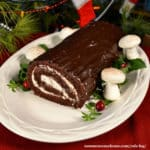 yule log cake near tree