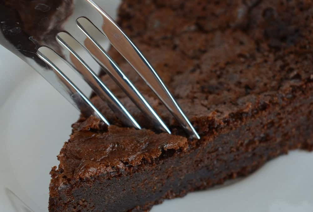 taking a bite of sourdough brownies
