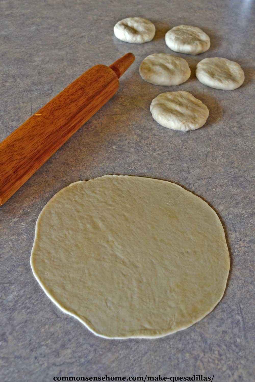 rolling out flour tortillas