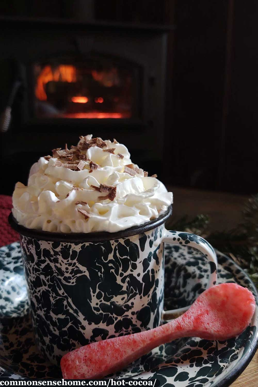 hot cocoa with whipped cream and peppermint spoon
