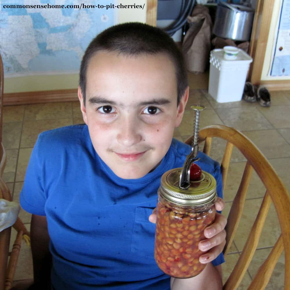 jar lid cherry pitter