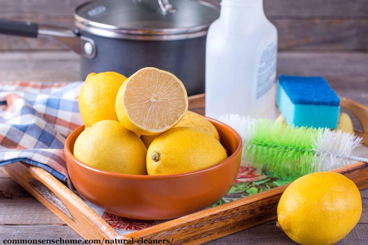 lemons, spray bottle, scrubbers